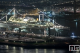 Te Koop | Het cruiseschip ss Rotterdam in Rotterdam Katendrecht in de avond