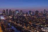 Te Koop | De skyline van Rotterdam met het Witte Huis tijdens zonsondergang