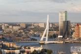 Te Koop | De Erasmusbrug en de Maastoren in Rotterdam tijdens zonsondergang