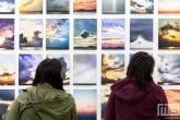 Een grote serie wolkenfoto's tijdens Art Rotterdam in de Van Nelle Fabriek in Rotterdam