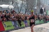 Belgische marathonloper Koen Naert op de Coolsingel in Rotterdam