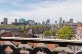 Het uitzicht op de binnenstad van Rotterdam vanaf het dak van het Industriegebouw