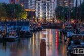 Te Koop | Het Witte Huis in Rotterdam by Night gezien vanuit het Haringvliet
