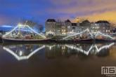 Het Hellinggat in Maassluis by Night met twee schepen
