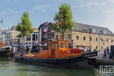 Het stoomschip Havendienst 20 tijdens het evenement Furiade aan de kade in Maassluis