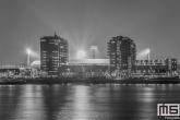 Te Koop | Het Feyenoord Stadion De Kuip in Rotterdam tijdens een speelavond in zwart/wit