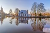 Te Koop | Het Veerhuis en de Grote Kerk in Rotterdam Overschie in de sneeuw