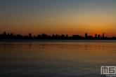 Te Koop | De skyline van Rotterdam vanaf de Kralingseplas in Rotterdam tijdens zonsondergang